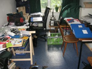 Cluttered living space in a home makes the room look smaller.